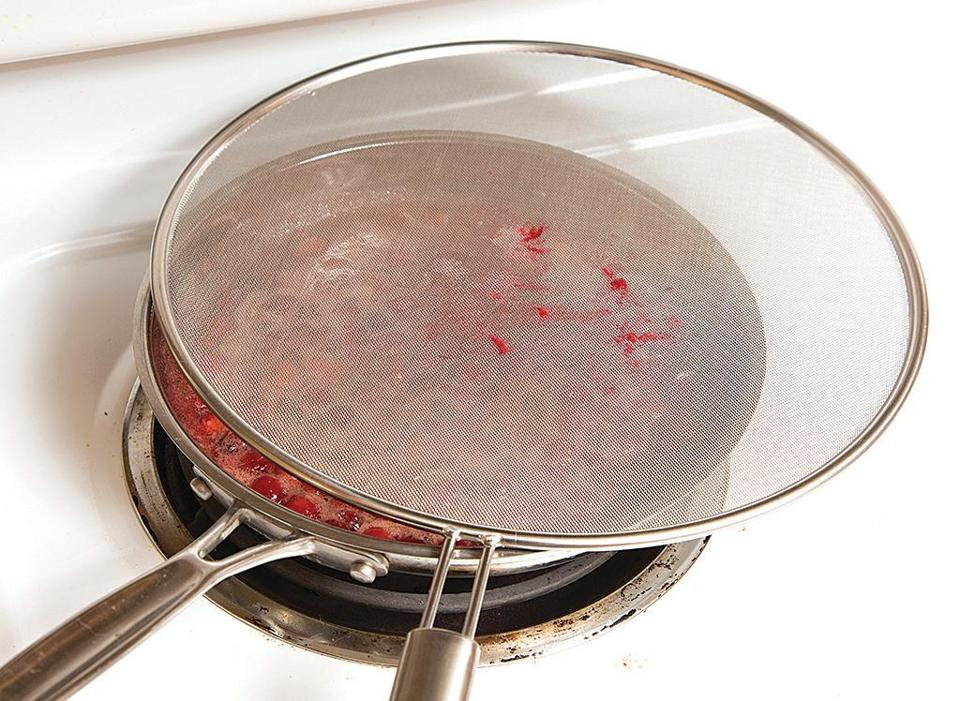 Cranberries pop as they cook and split open, which can launch drops of whatever liquid they're cooking in. My solution? I use a splatter screen to keep the hot liquid in the pan and off my body.