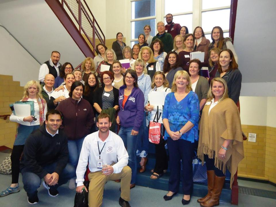 26nogloucester - Nickey Mullen of Lahey Health (front row, second from right) trained 90 faculty, staff, and administrators at Gloucester High School in mental health first aid. (Handout)