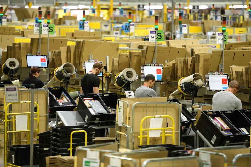 Workers prepared items for shipping earlier this month at an Amazon facility in Peterborough, England.