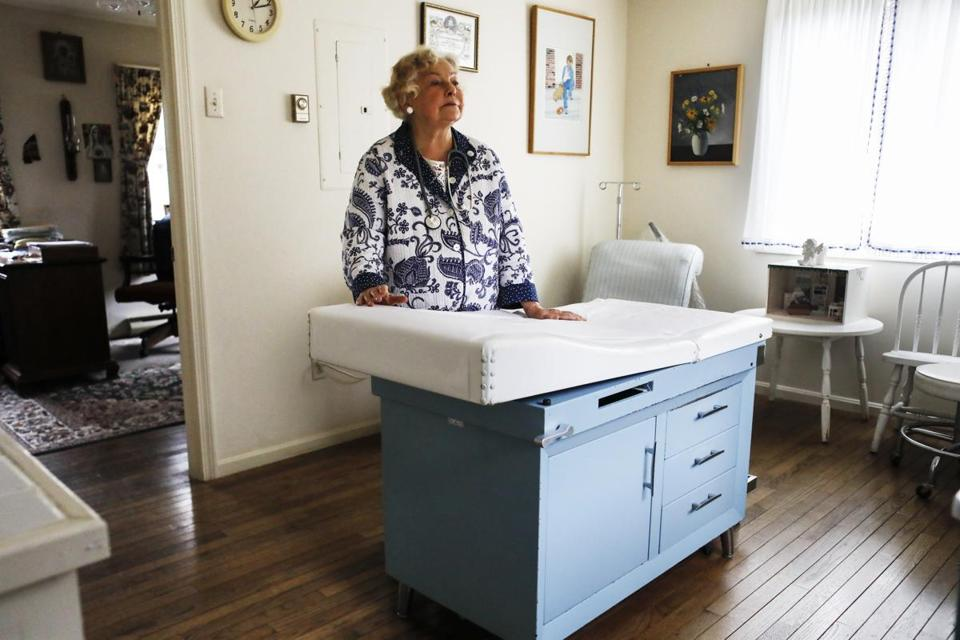 Dr. Anna Konopka, 84, stands in the examining room section of her three-room country doctor's office that is situated next to her home in New London, N.H., Saturday, Nov. 18, 2017. Dr. Anna Konopka, is trying to get her license back after it was revoked by the state medical board. She says it is because she refuses to pay for electronic health records, and doesn't trust them, and that other doctors don't like them either but are too afraid to speak out against this system put in place to benefit insurers rather than patient. (Cheryl Senter for STAT)
