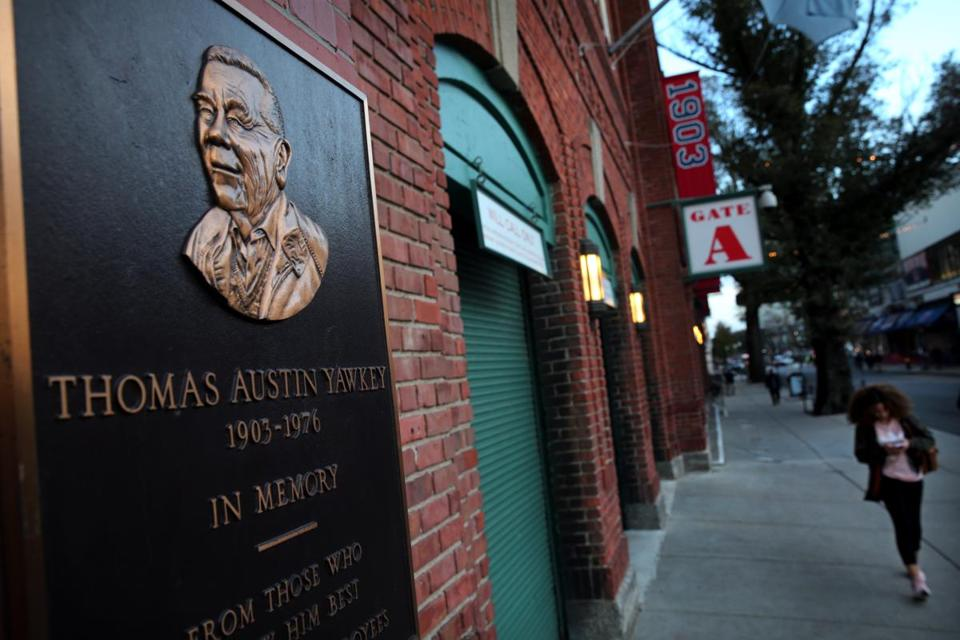 A plaque honoring Tom Yawkey at Fenway Park was seen on Yawkey Way.