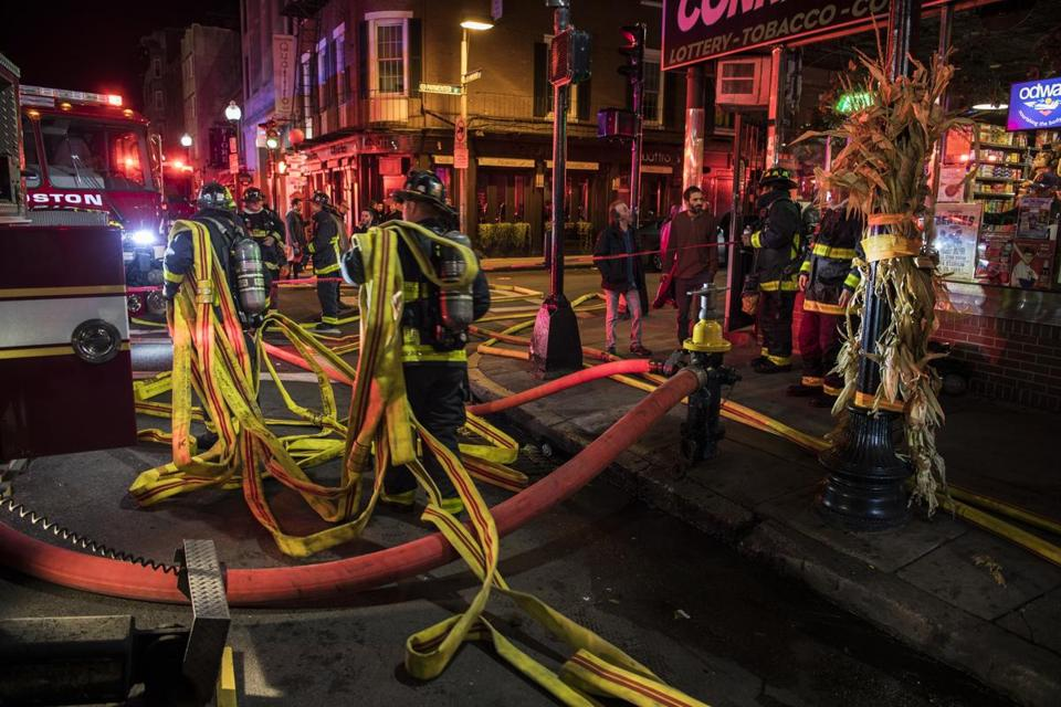 Firefighters hauled hoses at the scene of Wednesday's North End fire.