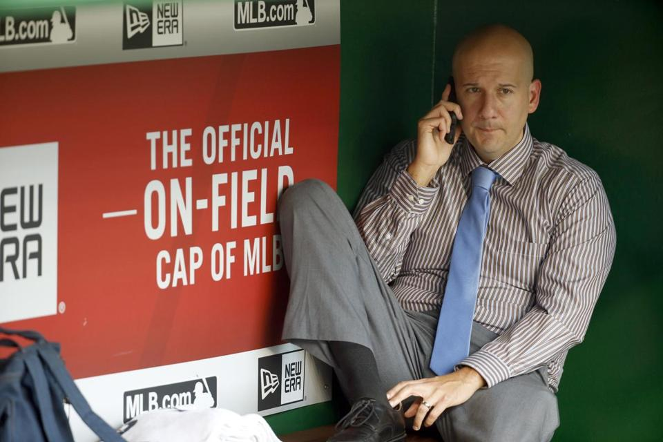FILE-This Sept. 4, 2015, file photo shows Atlanta Braves assistant general manager and director of pro scouting John Coppolella talking on the phone in the dugout during batting practice before a baseball game against the Washington Nationals at Nationals Park, in Washington. Baseball Commissioner Rob Manfred has hit the Atlanta Braves with heavy sanctions, including the loss of nine players, for rules violations committed by the team in the international player market. Manfred on Tuesday, Nov. 21, 2017, also placed former Braves general manager Coppolella on the permanently ineligible list. Former Braves Special Assistant Gordon Blakeley, the team's international scouting chief, is suspended from performing services for any team for one year. (AP Photo/Alex Brandon, File)