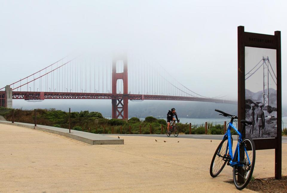 A bike path slices across Battery East at the Presidio, with resplendent views of the Golden Gate Bridge.