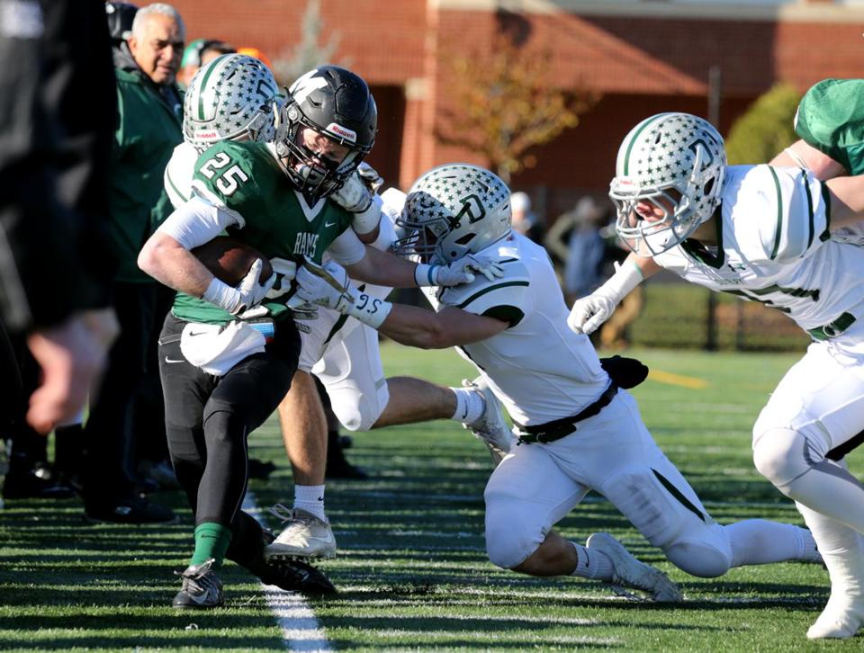 Marshfield's Brendan Ward is driven out of bounds by the Duxbury defense.