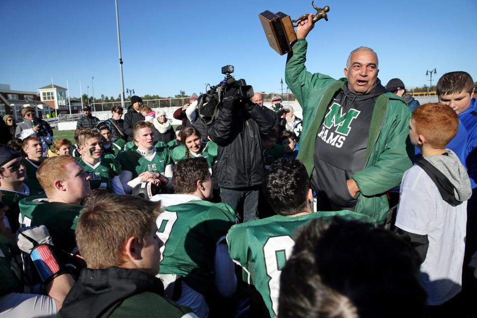 MARSHFIELD, MA- NOVEMBER 23, 2017- : Marshfield coach Lou Silva speaks to his team after winning the annual high school football game between Marshfield and Duxbury in Marshfield, MA on November 23, 2017. Marshfield won the 23rd annual high school football game between Marshfield and Duxbury. ( CRAIG F. WALKER/GLOBE STAFF) section: sports reporter: Marshfield 37-year coach Lou Silva