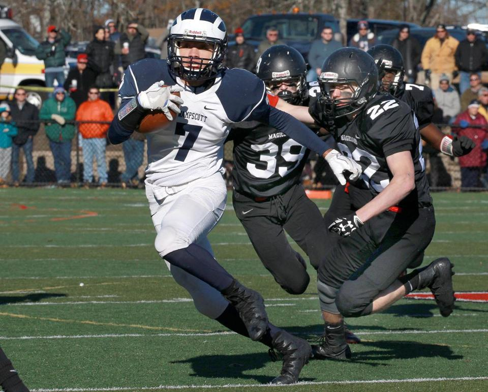Swampscott's Isaiah Bascon (7) led the way on this rush in the first quarter.