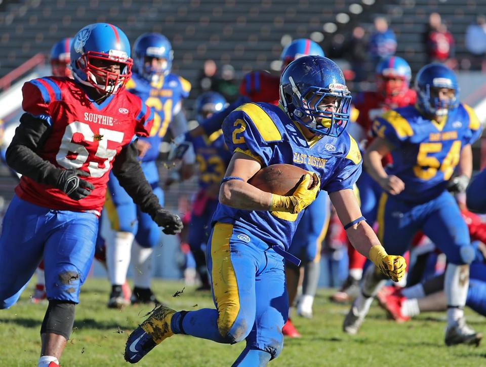 Boston MA 11/23/17 East Boston High running back Brandon Ortega heads upfield in front of South Boston High Jaleel Orleber during first quarter action of their Thanksgiving Day game at White Stadium. (Matthew J. Lee/Globe staff) topic reporter: