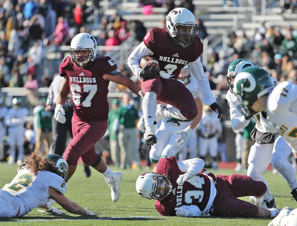 Lynn MA 11/23/17 Lynn English High's running back Ski Gaston hurdles his offensive line picking up extra yardage against Lynn Classical during second half action of their Thanksgiving Day game at Manning Field. (Matthew J. Lee/Globe staff) topic reporter: