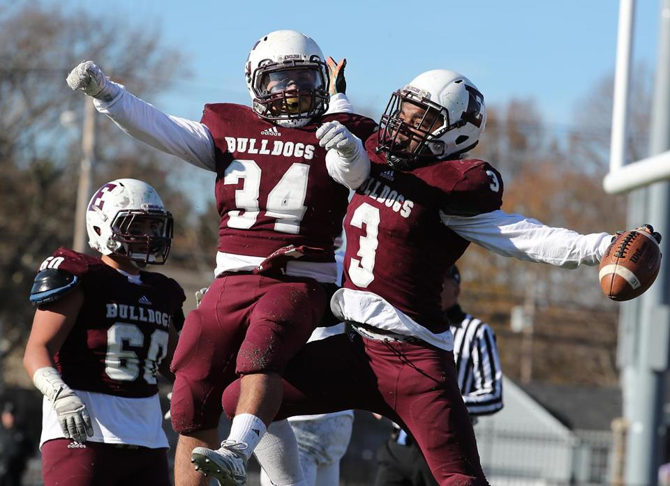 Lynn English's Ski Gaston (right) celebrates his touchdown reception with Jose Matul.