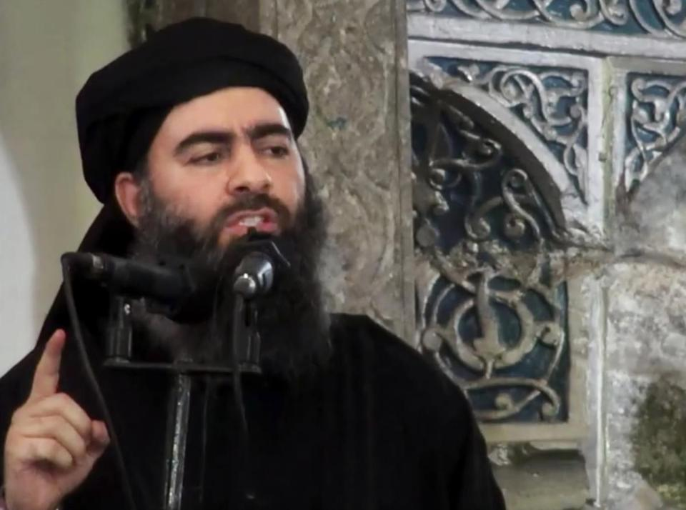 "FILE - This image made from video posted on a militant website July 5, 2014, purports to show the leader of the Islamic State group, Abu Bakr al-Baghdadi, delivering a sermon at a mosque in Iraq during his first public appearance. The Islamic State is targeting Western recruits with videos suggesting they too can be a hero like Bruce Willis' character in ""Die Hard.""(Militant video via AP, File)"