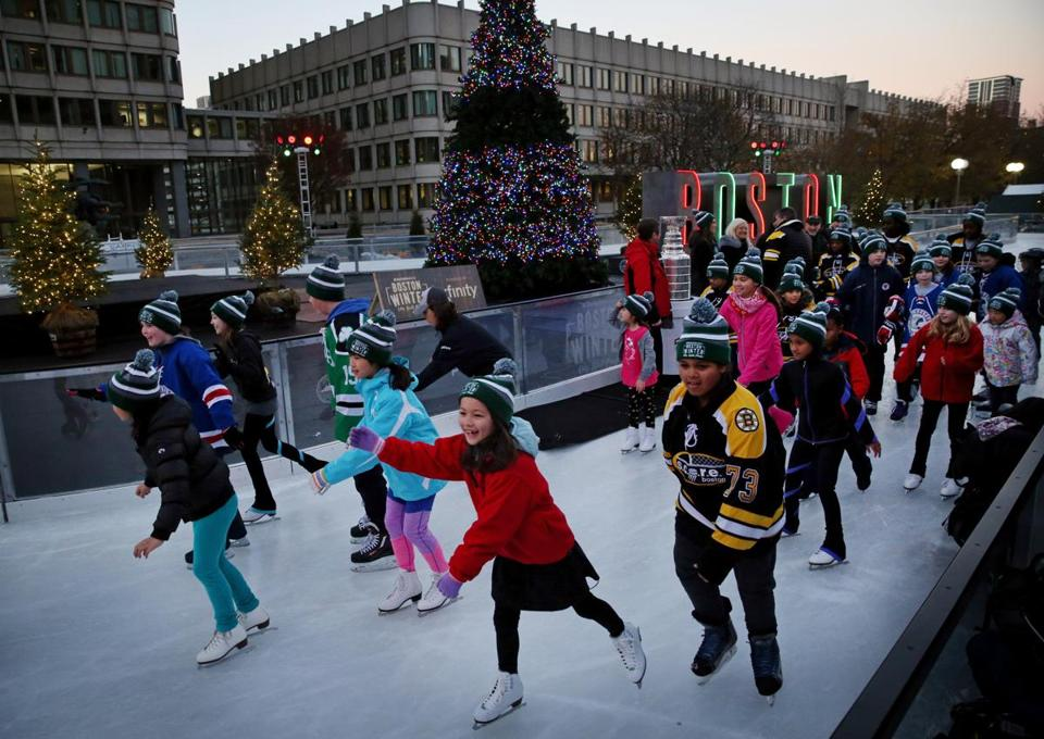 "BOSTON, MA- NOVEMBER 24, 2017- : After the lighting of Boston Winter Holiday Tree youths took part in the First skate on the Ice Skating Path during the opening celebration at ""Boston Winter presented by Berkshire Bank"" at City Hall Plaza in Boston, MA on November 24, 2017. (The open-air holiday festival, returned to City Hall Plaza on Friday, November 24. The opening ceremony celebration included a ribbon cutting, tree lighting, return of the ""Boston"" marquee sign and a ceremonial first skate on New England's only Skating Path with a very special visit from the most revered trophy in all of sports the Stanley Cup®.) ( CRAIG F. WALKER/GLOBE STAFF) section: metro reporter:"