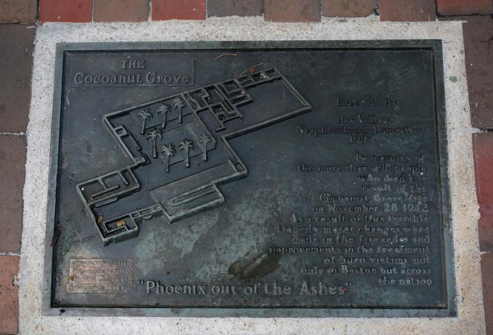A plaque honors the 492 people killed in the fire.