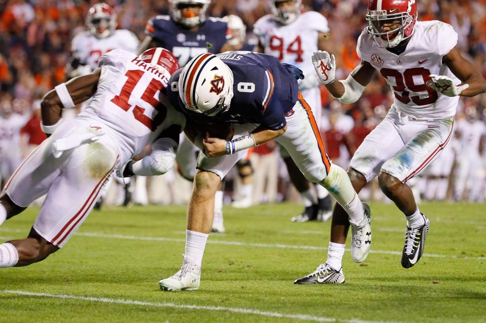 AUBURN, AL - NOVEMBER 25: Jarrett Stidham #8 of the Auburn Tigers rushes for a touchdown during the fourth quarter against the Alabama Crimson Tide at Jordan Hare Stadium on November 25, 2017 in Auburn, Alabama. (Photo by Kevin C. Cox/Getty Images)