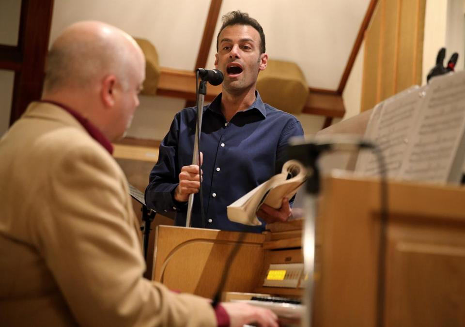 Andrew Giordano sings during a church service at St. Barbara Parish Church accompanied by Todd Theriault, principal musician at the church.