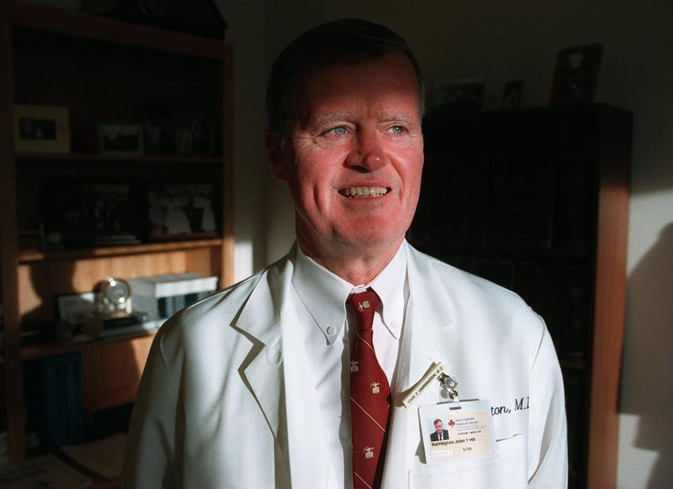 Dr. Harrington in his office in 1996, when he was appointed dean of the medical school.