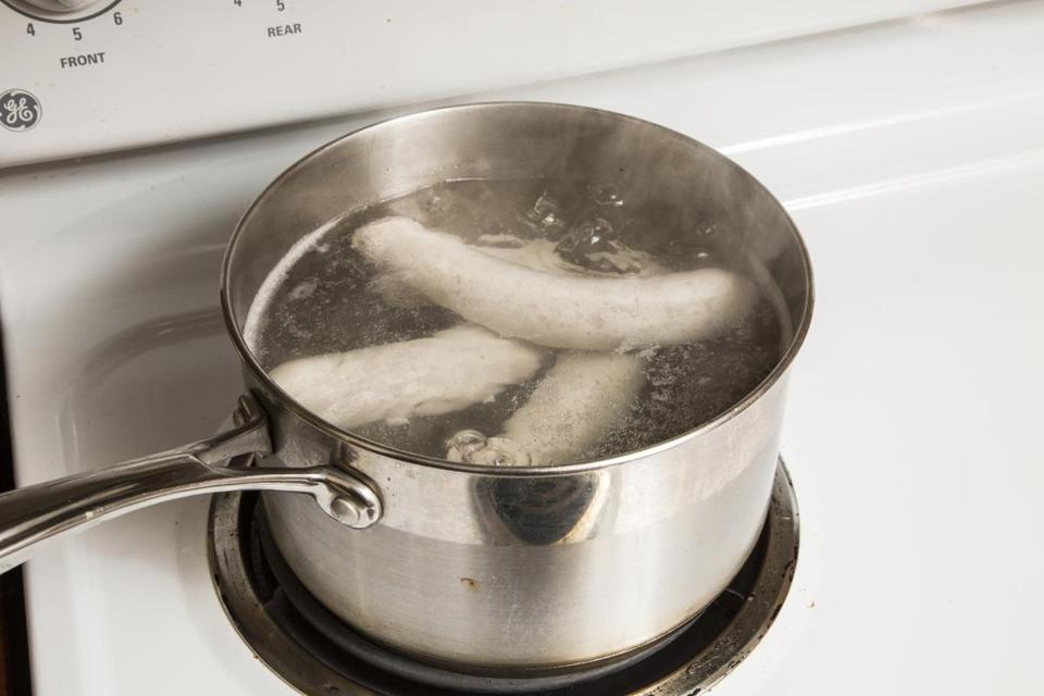 Blanching fresh sausages can remove a little fat before they roast. In a large pot, bring about 2 quarts of water to a boil. With a dinner fork, prick each sausage several times along its length. Add them to the water, reduce the heat to medium, simmer for about 5 minutes, drain, and dry the sausages.