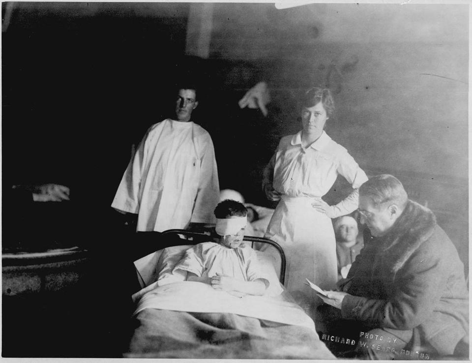 A.C. Ratshesky sits with George Arthur, wounded in the explosion, and Boston nurse Edith Choate.