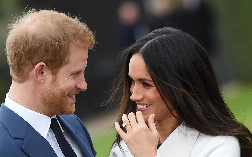 Mandatory Credit: Photo by FACUNDO ARRIZABALAGA/EPA-EFE/REX/Shutterstock (9243933ac) Prince Harry and Meghan Markle Prince Harry and Meghan Markle engaged, London, United Kingdom - 27 Nov 2017 Britain's Prince Harry (L) poses with his fiancee, US actress Meghan Markle during a photocall after announcing their engagement in the Sunken Garden at Kensington Palace in London, Britain, 27 November 2017. Clarence House said in a statement that the couple's wedding ceremony will take place in spring 2018.