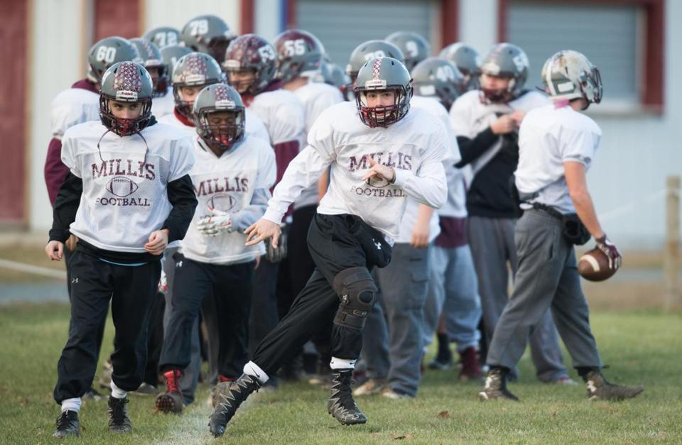 Millis football player Jake McKee runs a drill during practice in preparation of their Division 8 game Superbowl game against Hoosac Valley in Millis, Mass., Monday, Nov. 27, 2017. Gretchen Ertl for The Boston Globe.