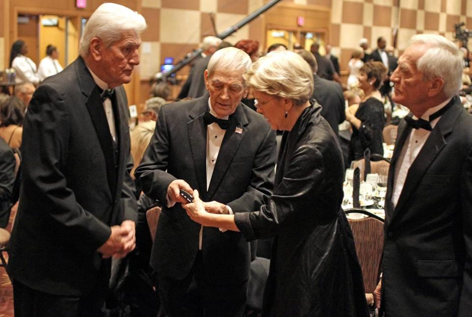 Elizabeth Warren inducted into the Oklahoma Hall of Fame at the Cox Convention Center in Oklahoma City. She was accompanied by her three older brothers; John Herring (left), Don Herring (middle), and David Herring (right).