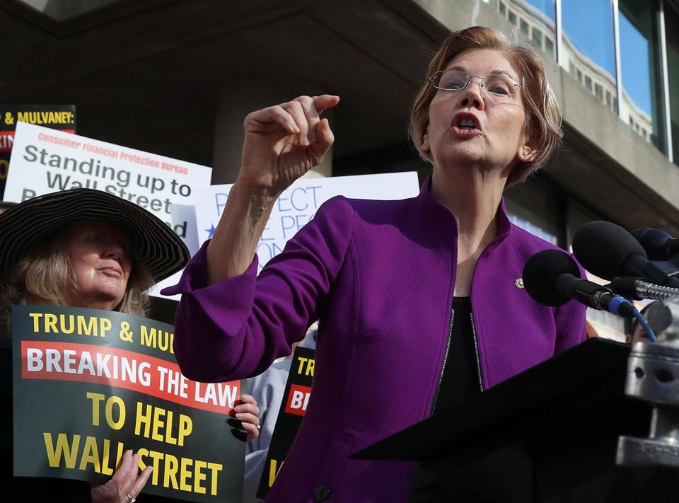 Senator Elizabeth Warren headlined a demonstration of about 40 people protesting President Trump's pick of budget director Mick Mulvaney as the bureau's new leader.