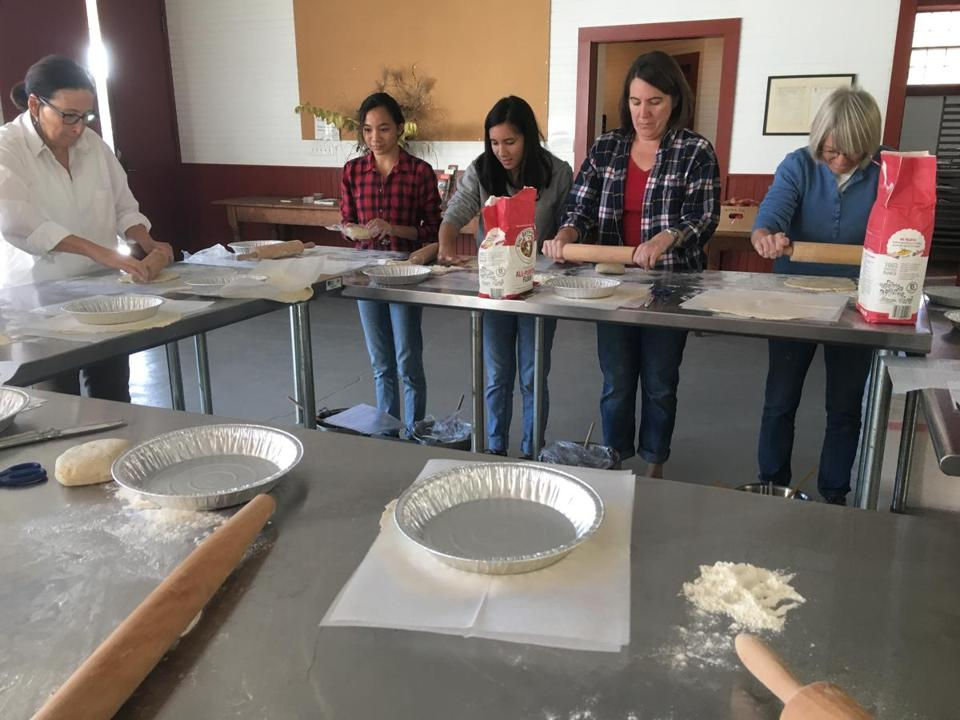 Participants in an apple pie class at Scott Farm in Dummerston, Vt.