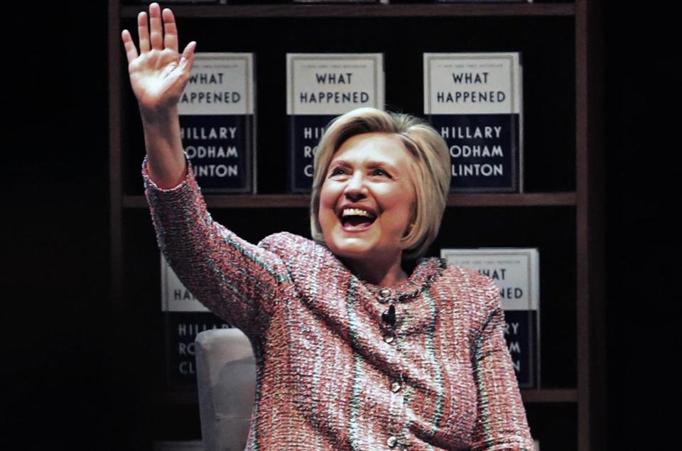 "Hillary Clinton waved to the crowd at the Opera House on Tuesday. The stop was part of a 16-city national tour to promote her book, ""What Happened."""