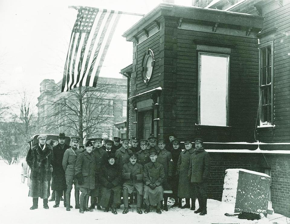 A group of American relief workers, probably including Harvard doctors, standing in front of the converted Bellevue Hospital on Spring Garden Road at Queen Street.