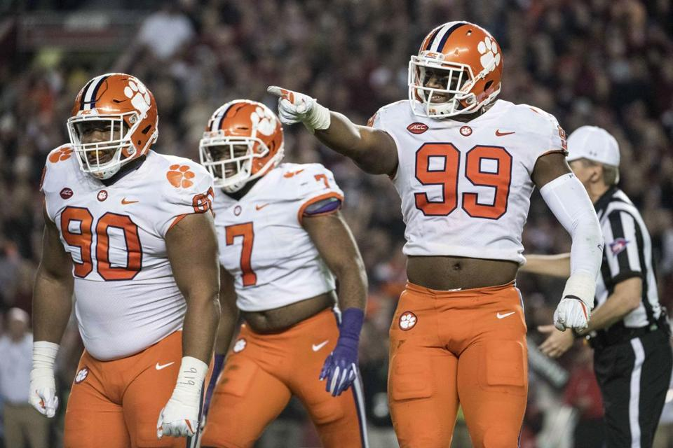 Clemson defensive end Clelin Ferrell (99), Dexter Lawrence (90) and Austin Bryant (7) react after a sack during the first half of an NCAA college football game against South Carolina on Saturday, Nov. 25, 2017, in Columbia, S.C. Clemson defeated South Carolina 34-10. (AP Photo/Sean Rayford)