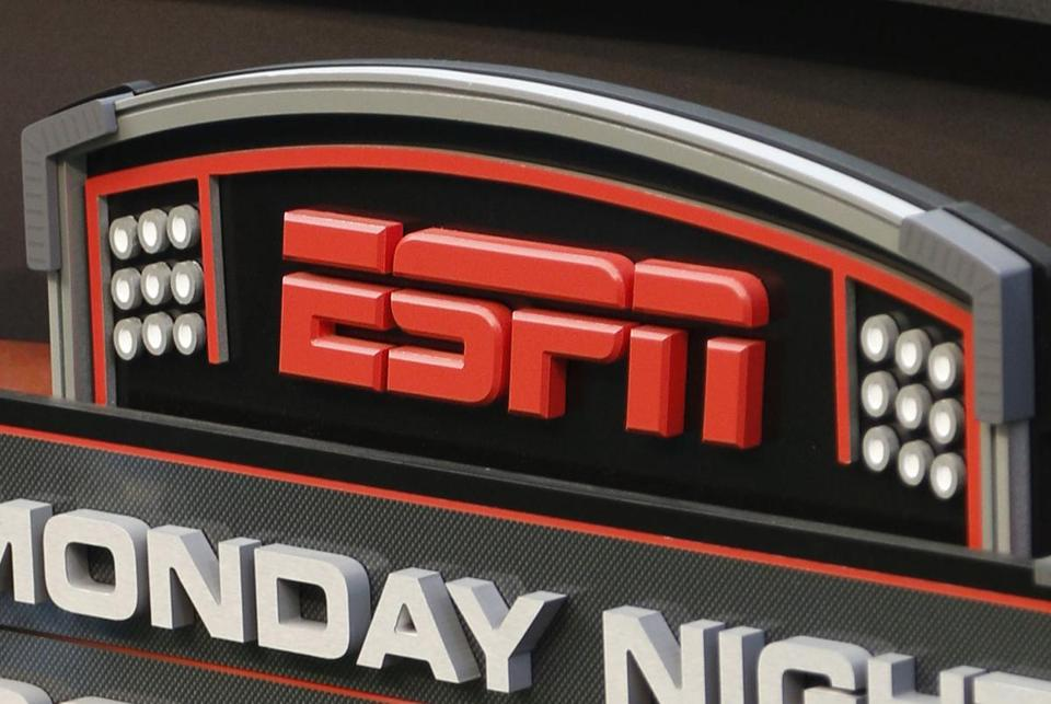 FILE - This Sept. 16, 2013, file photo shows the ESPN logo prior to an NFL football game between the Cincinnati Bengals and the Pittsburgh Steelers, in Cincinnati. ESPN says it is eliminating 150 studio and production employees as the sports broadcasting giant continues to shift its focus to a more digital future. The company says the layoffs, which were announced Wednesday morning, Nov. 29, 2017, in a memo to employees, don't include on-air talent and will have a minimal impact on the network's signature SportsCenter news program. (AP Photo/David Kohl, File)