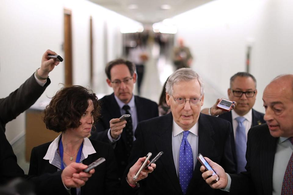 Senate Majority Leader Mitch McConnell talks with reporters after leaving a tax reform news conference in the Dirksen Senate Office Building on Capitol Hill on Thursday.