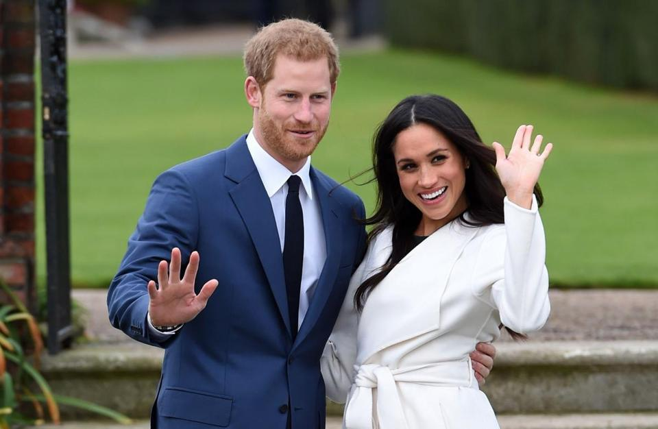 Prince Harry and Meghan Markle posed for pictures on the grounds of Kensington Palace in London after announcing their engagement.