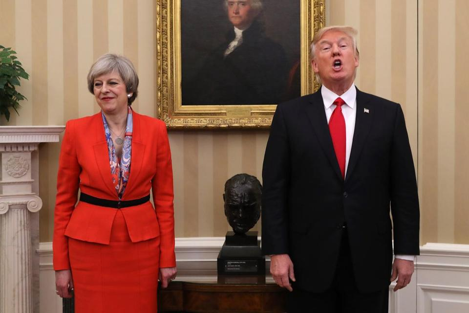 WASHINGTON, DC - JANUARY 27: (One of a 115-image Best of Year 2017 set) British Prime Minister Theresa May looks on as U.S. President Donald Trump speaks in The Oval Office at The White House on January 27, 2017 in Washington, DC. British Prime Minister Theresa May is on a two-day visit to the United States and will be the first world leader to meet with President Donald Trump. (Photo by Christopher Furlong/Getty Images)