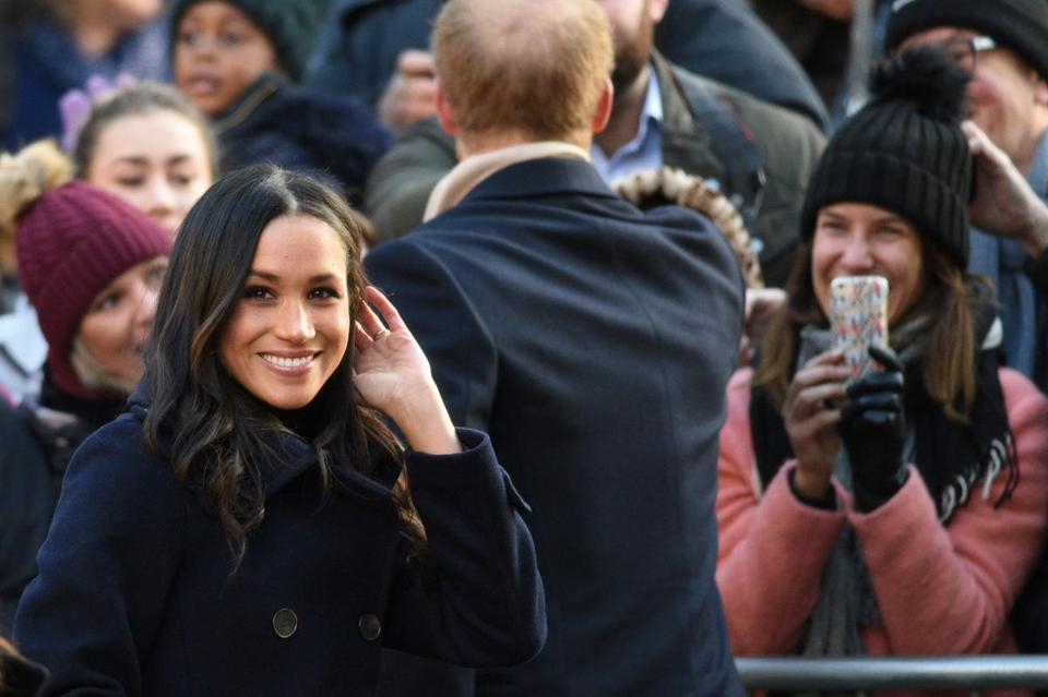 Britain's Prince Harry and his fiancee US actress Meghan Markle greet wellwishers on a walkabout as they arrive for an engagement at Nottingham Contemporary in Nottingham, central England, on December 1, 2017 which is hosting a Terrence Higgins Trust World AIDS Day charity fair. Prince Harry and Meghan Markle visited Nottingham in their first set of engagements together since announcing their engagement. / AFP PHOTO / Oli SCARFFOLI SCARFF/AFP/Getty Images