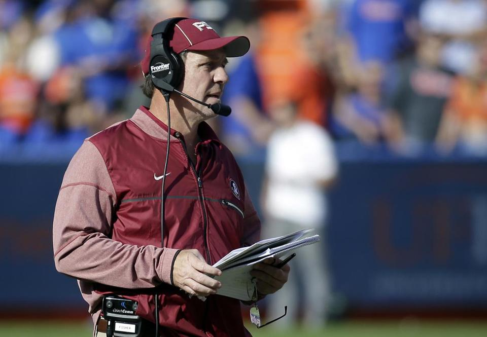 Florida State head coach Jimbo Fisher watches play against Florida during the second half of an NCAA college football game, Saturday, Nov. 25, 2017, in Gainesville, Fla. Florida State won 38-22. (AP Photo/John Raoux)