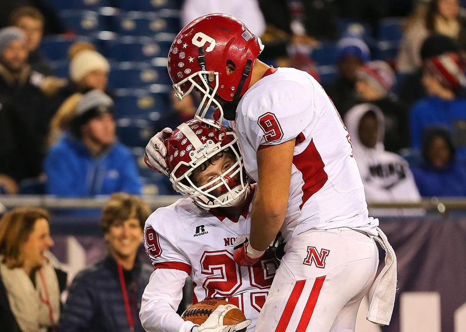 Foxborough-12/1/17- Division 3 superbowl- North Attleboough vs St. John's of Shrewsbury. North Attleborough's Brendan McHugh(left) is congratulated by Nicholas Raneri after McHugh's 2nd qtr touchdown. John Tlumacki/Globe Staff(sports)
