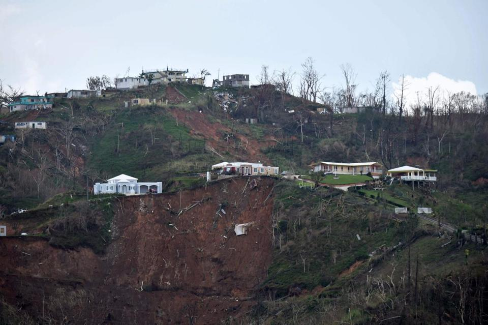 Damaged homes amid mudslides from Hurricane Maria.