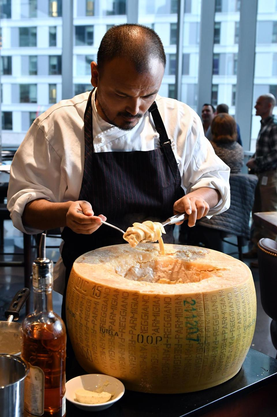 Executive Chef Nimesh Maharjan prepares Tagliatelle at Tartufo finished in the hollow of a Parmesan cheese wheel at Tuscan Kitchen in the Seaport. Josh Reynolds for The Boston Globe (Lifestyle, first)