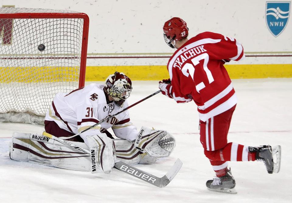 Chestnut Hill, MA - 12/01/2017 - (1st period) Boston University Terriers forward Brady Tkachuk (27) scores a short handed goal past Boston College Eagles goalie Joseph Woll (31) for the 3-2 lead in the first period. BC-BU hockey at Conte Forum. - (Barry Chin/Globe Staff), Section: Sports, Reporter: Globe Staff, Topic: 02BC-BU Hockey, LOID: 8.4.213984789..