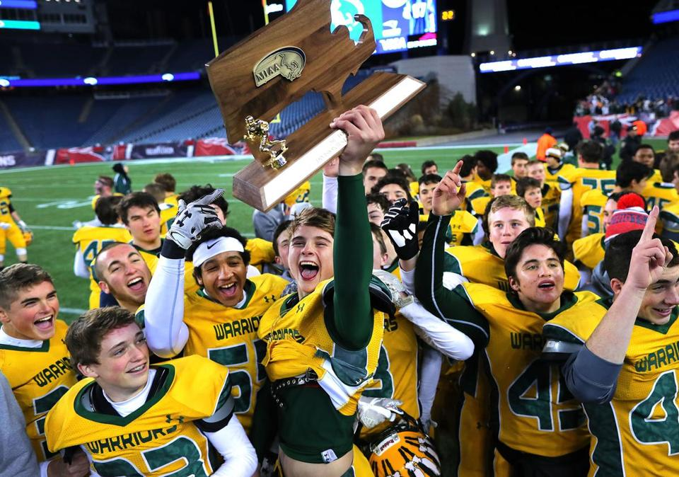 Foxborough-12/1/17- Division 2 superbowl- Lincoln-Sudbury vs King Philip- Superbowl champions King Philip celebrate with their trophy. John Tlumacki/Globe Staff(sports)