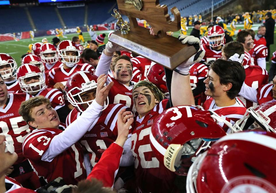 Foxborough-12/1/17- Division 3 superbowl- North Attleboough vs St. John's of Shrewsbury. St. John's players hoist up their superbowl trophy. John Tlumacki/Globe Staff(sports)