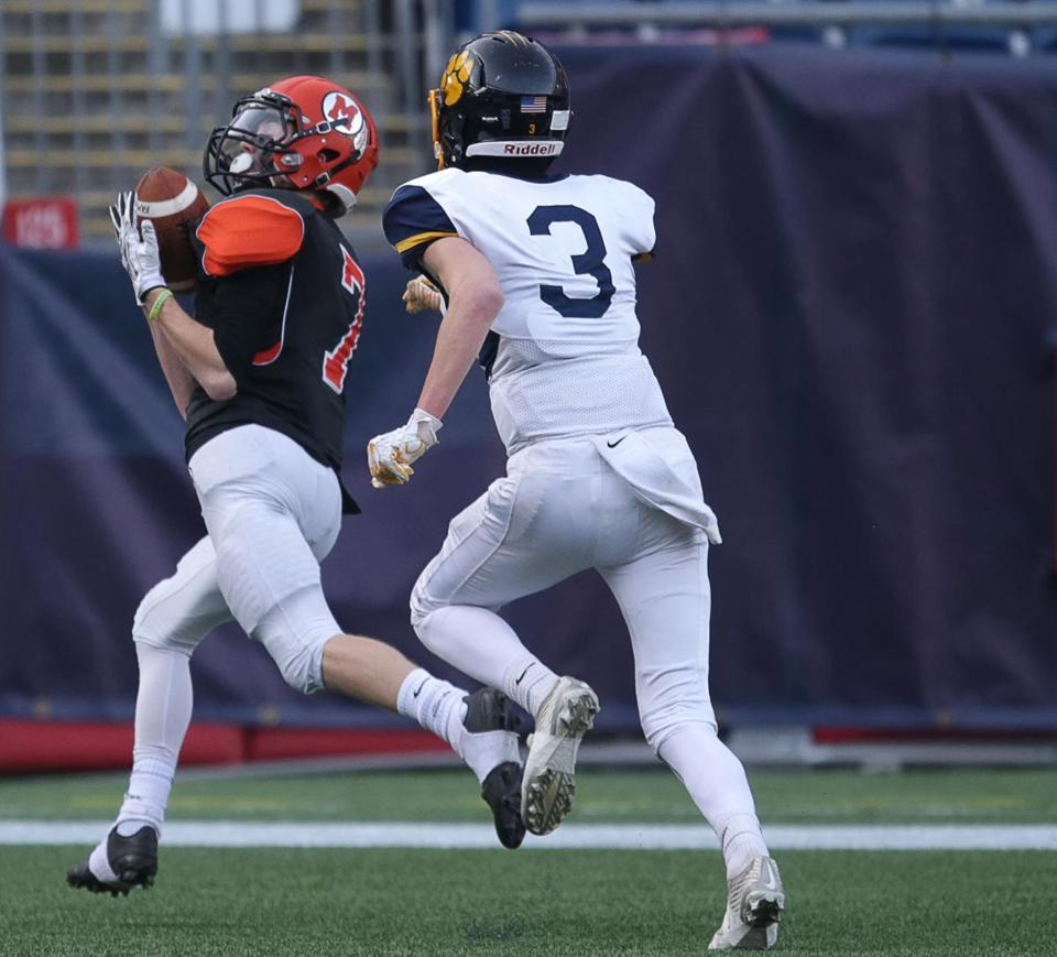 Middleborough's Colin O'Brien heads to the end zone as Littleton's Evan Lyons keeps up the chase Saturday at Gillette Stadium.