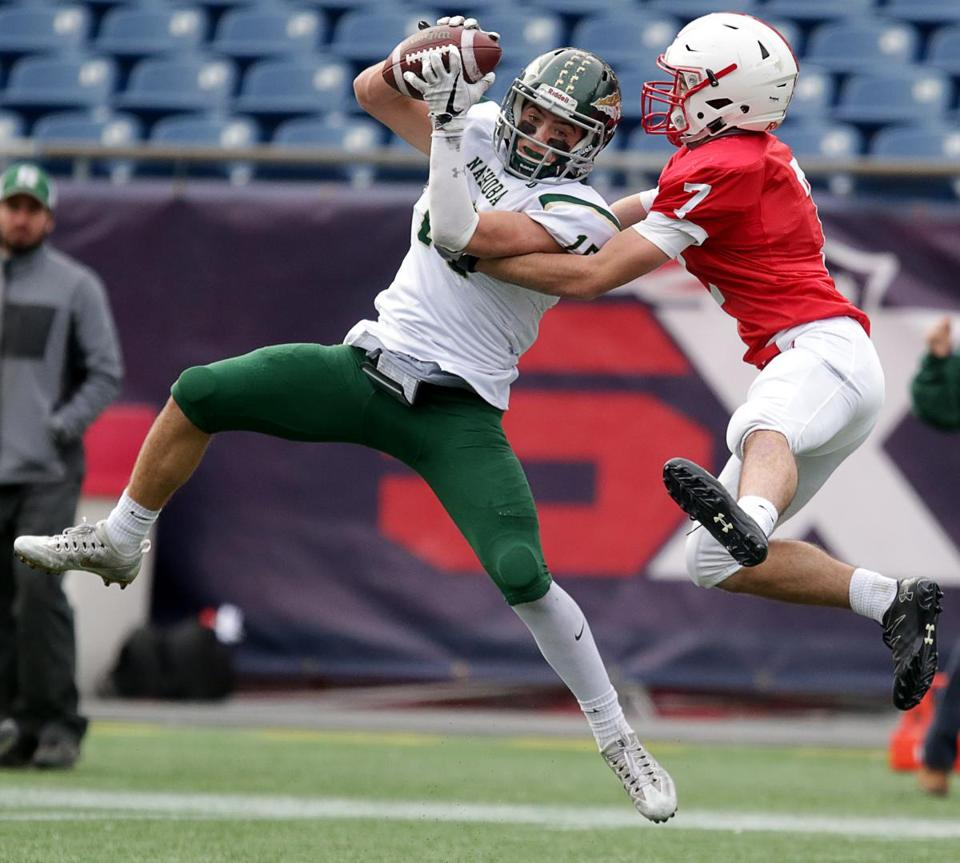 Nashoba's Breese Hill pulls in an interception during the Division 4 Super Bowl at Gillette Stadium.