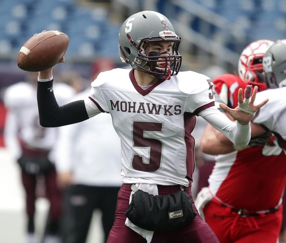 Sure-armed and dangerous,  Millis QB Bryce Latosek (5) found Andrew Brooks with a 50-yard TD strike that gave the Mohawks an insurmountable 24-0 halftime lead over Hoosac Valley.