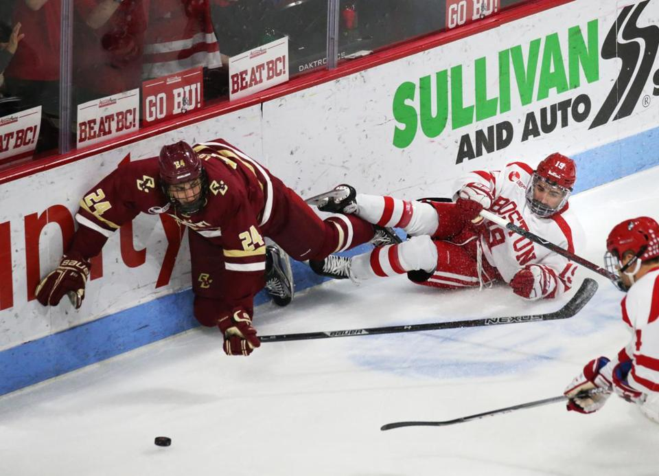 Boston, MA- DECEMBER 02, 2017: Boston College #24 Kevin Lohan and Boston University #19 Hank Crone battle for the puck during the first period of the mens hockey game between Boston University and Boston College at the Agganis Arena in Boston, MA on December 02, 2017. (CRAIG F. WALKER/GLOBE STAFF) section: sports reporter: