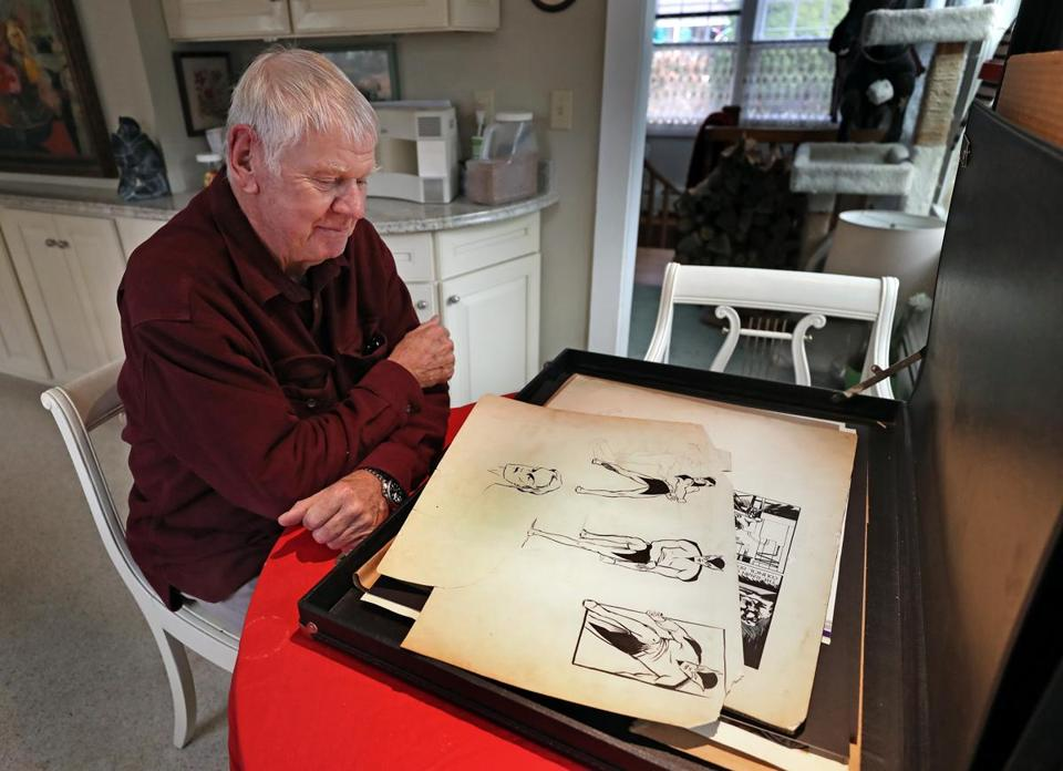 Frank Foster lll in his Cape Cod home with drawings his father made in the 1930's of batman.