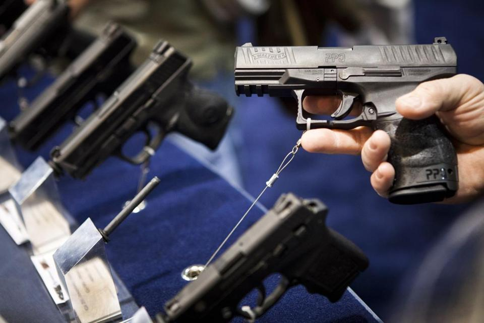 A Walther handgun is displayed at the Smith & Wesson booth at the Safari Club International Convention in Reno, Nevada in this file photo taken January 29, 2011.