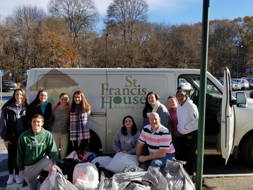 10noinformer - Billerica High Key Club members with the clothing donations they gathered for the St. Francis House shelter in Boston. (Handout)