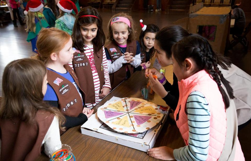 Dec. 3, 2017 - Girl Scouts play a cookie themed trivia game at the annual Cookie Kickoff at the beginning of the cooking selling at the Concord Scout House in Concord, Mass. Photo Credit: Justin Saglio for the Boston Globe. Section: Regional. Slug: 17zogirlscoutswest. Reporter: Hattie Bernstein.